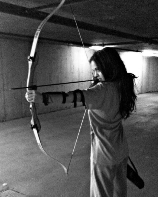 Zoe Shaw nocking an arrow